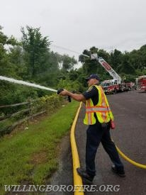 "Firefighter Priest operating an 1 3/4"" hoseline"